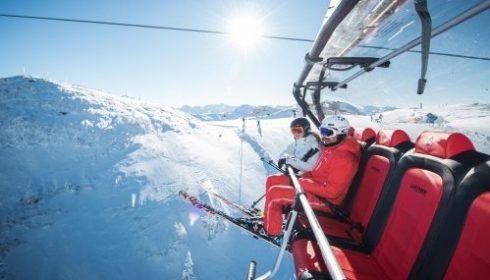 empty red chair lift in Kitzbühel Austria