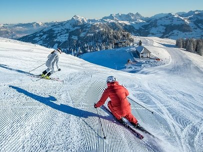 two solo skiers in Kitzbühel Austria