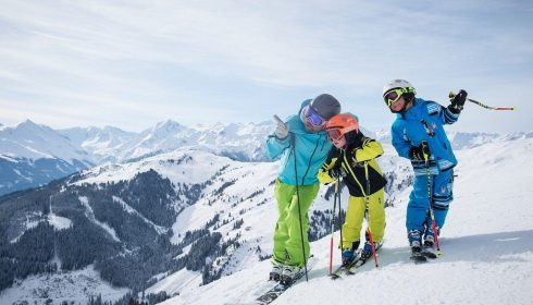 adult and children skiers on single parent ski holiday in Austria