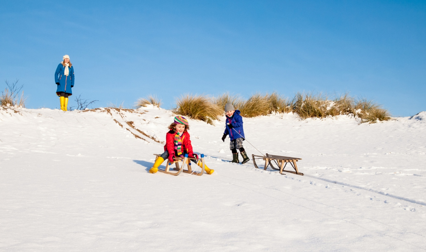A single parent's guide to travelling at Christmas - tobogganing
