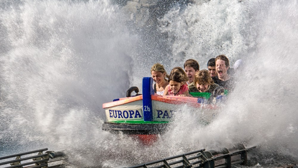kids on water ride in theme park on road trip