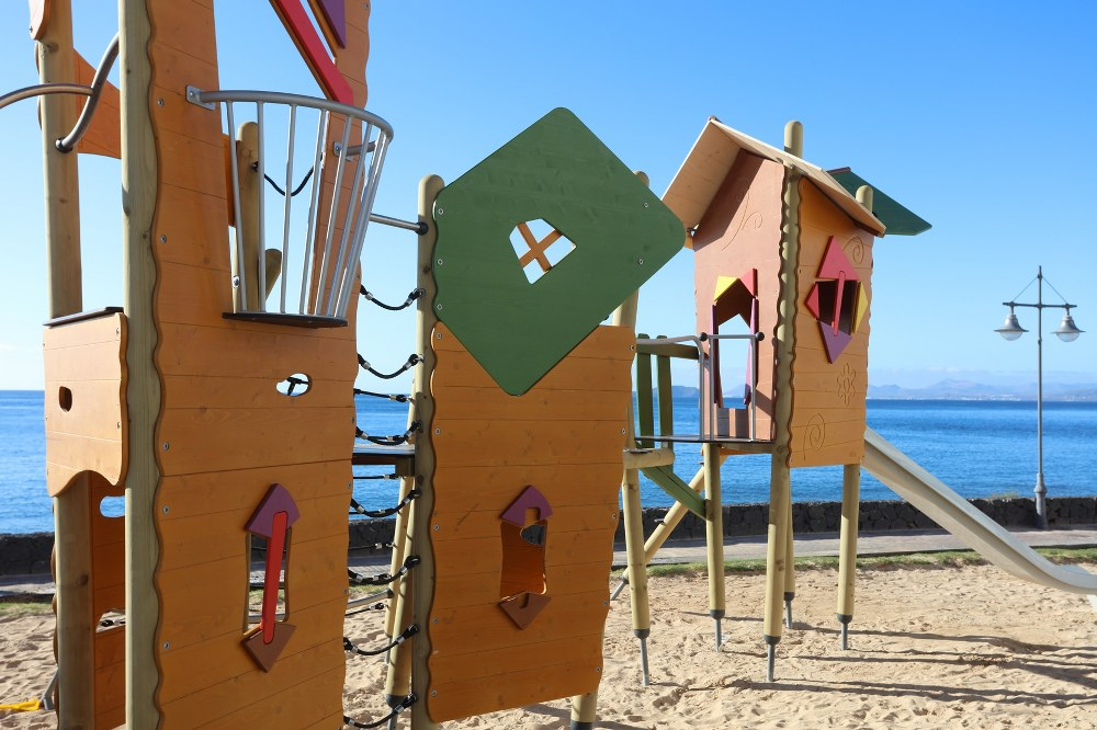 single mum holidays - playground overlooking the beach