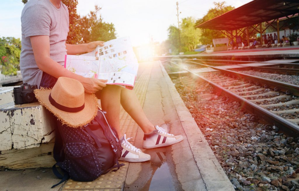 holiday with kids: girl at train station waiting for departure