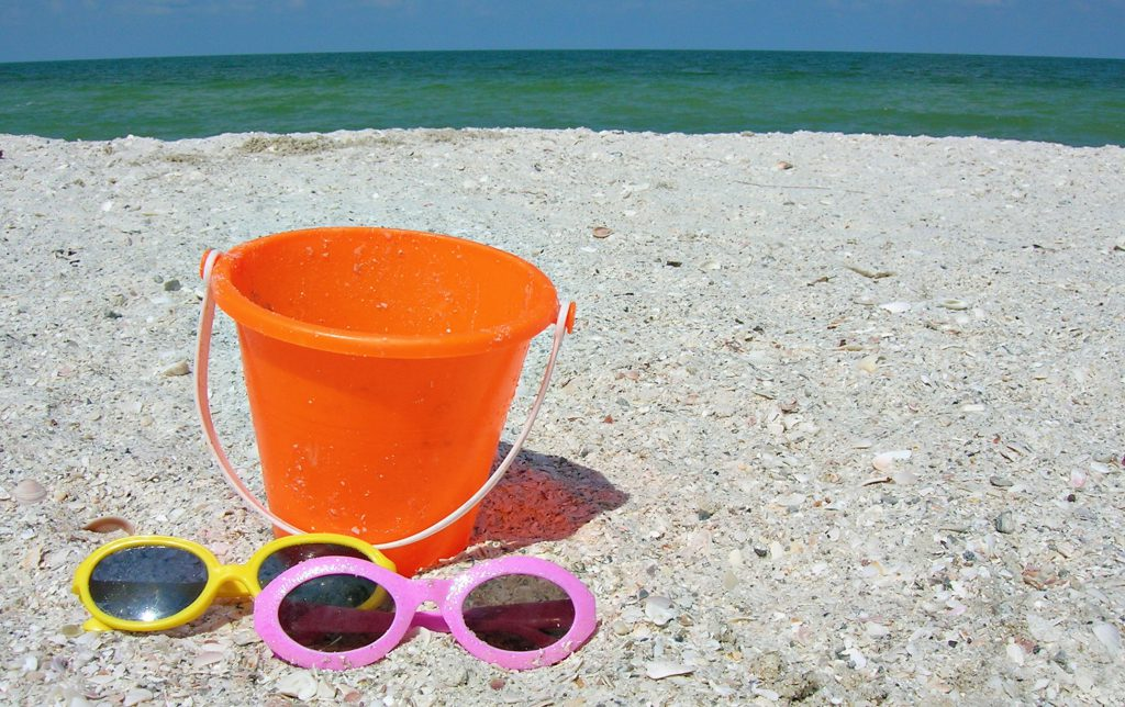 holiday with kids - sun glasses and bucket