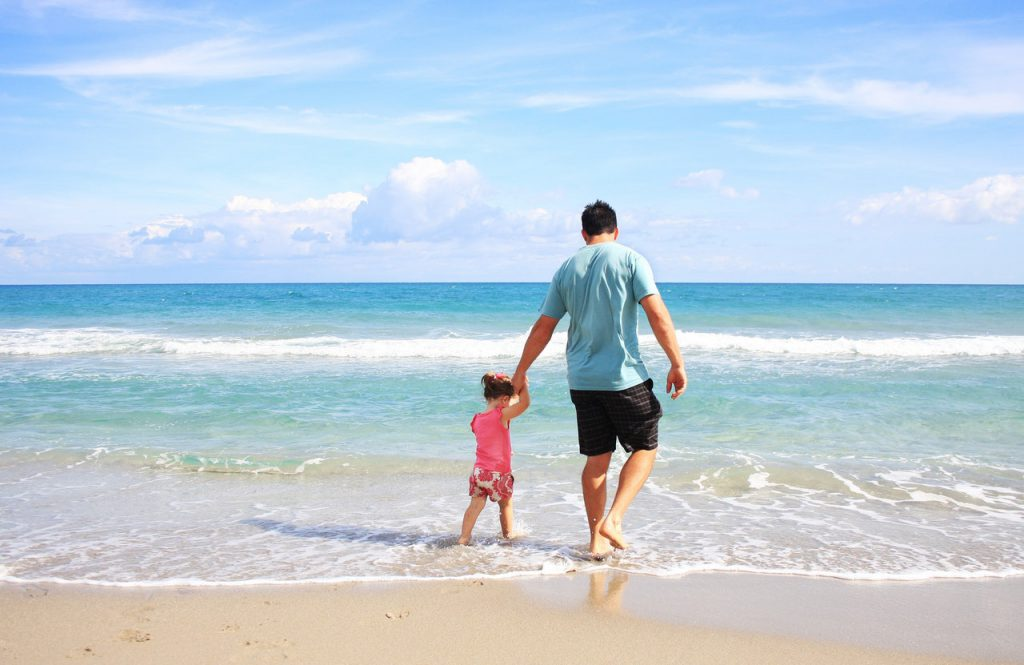 beach holiday with kids - father and daughter