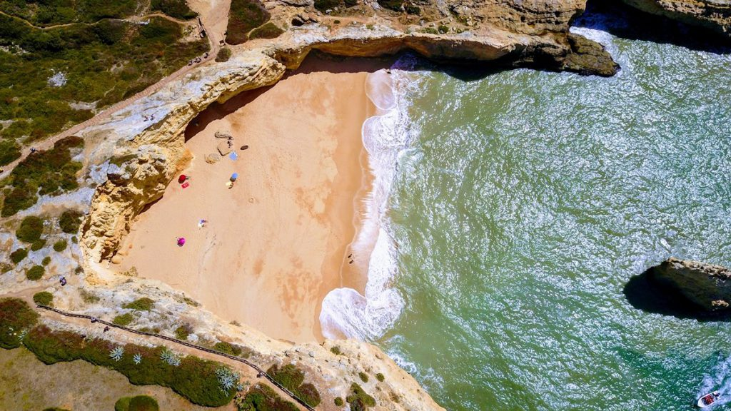 visit a beach in the Algarve
