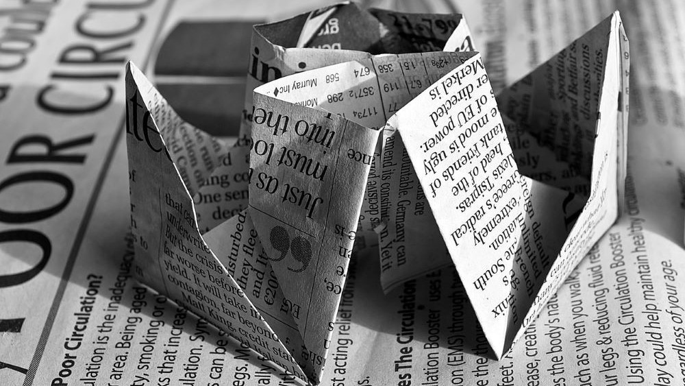 single parent benefits and money saving tips - re-use old newspaper for craft