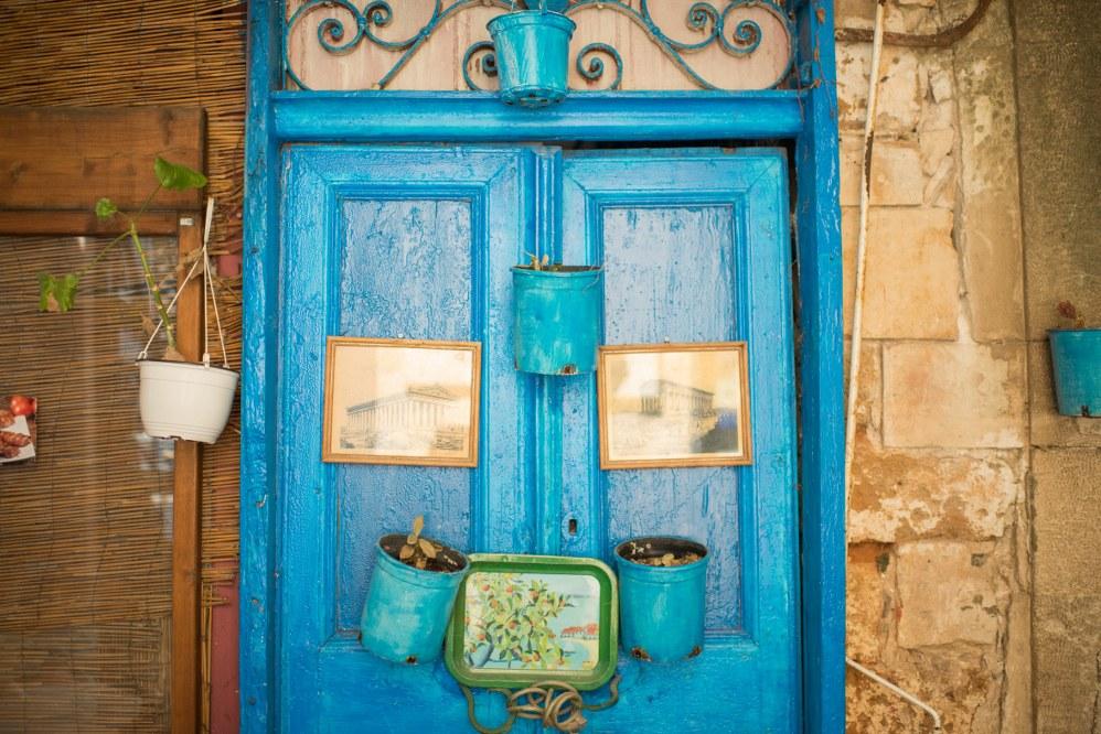 Crete facts - blue door with flower pots in Crete
