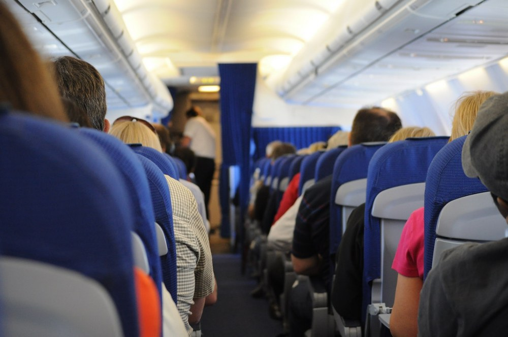 flying with kids - reserve seats on plane