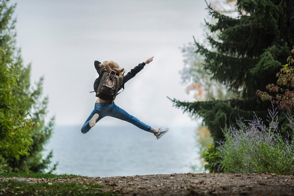 single parent dating -woman jumping with joy