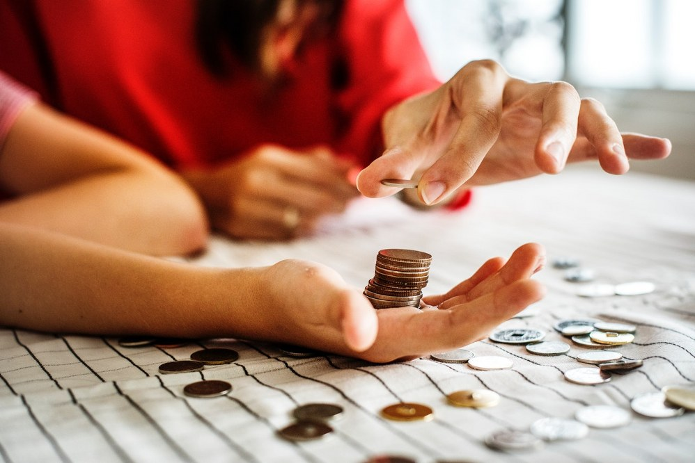 solo parenting - mother and child counting money