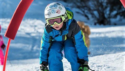 single boy racing on ski holiday in Kitzbühel Austria