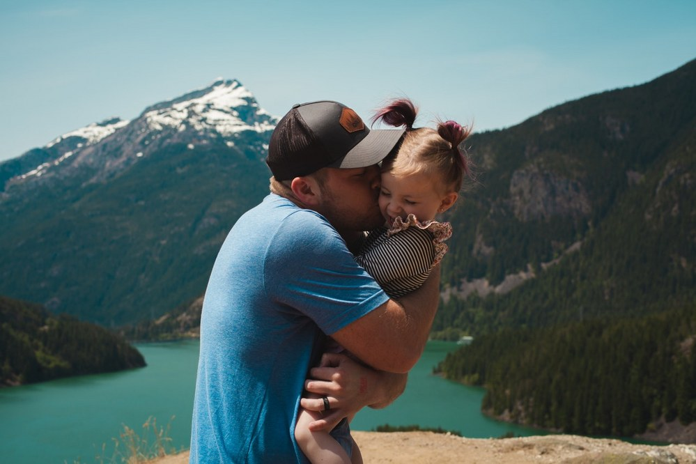 single dad holidays - dad with daughter in mountains