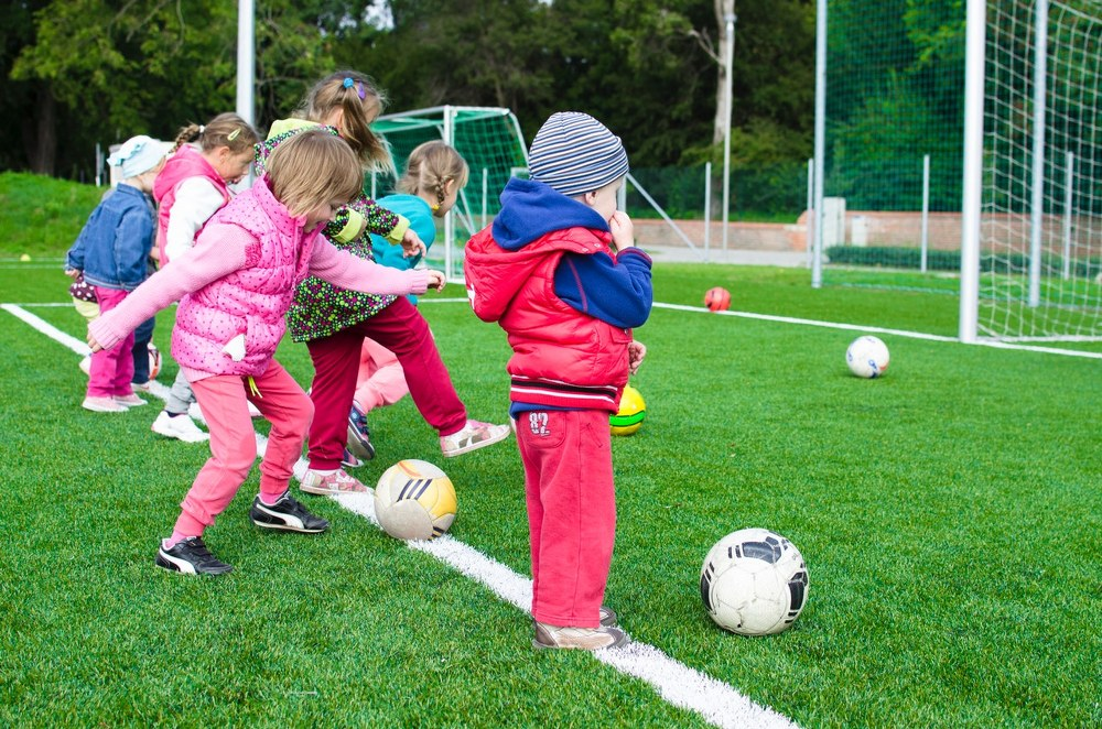 family activities - kids playing on football field