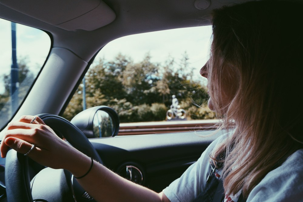 single mum driving on road trip with kids