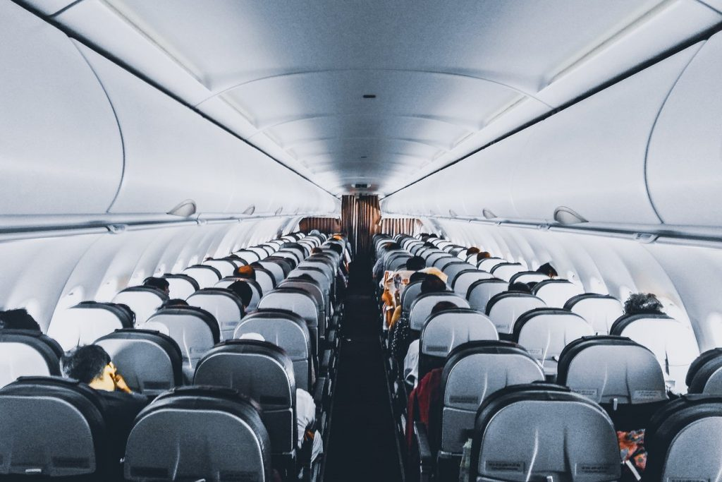 why do flight prices change - rows of seats in plane