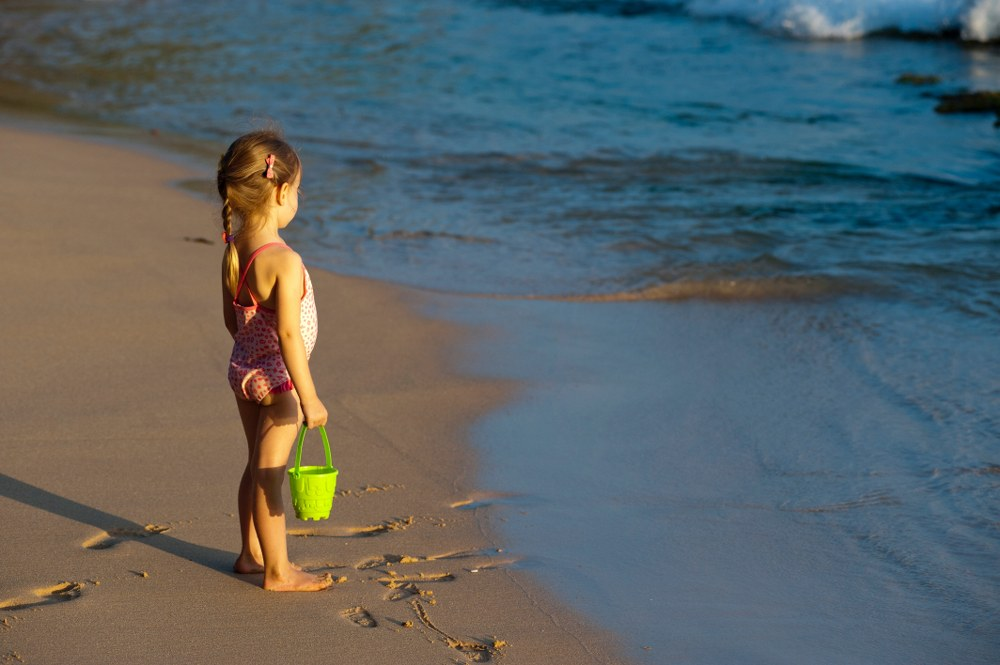 save for holiday - girl at the beach