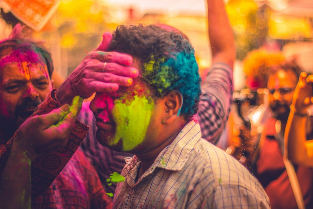 Holi festival in India - painting strangers face