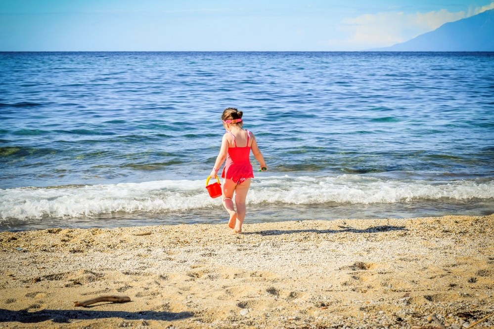 things to do with kids in Ibiza - girl with bucket