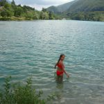 child swimming in Lake Barcis