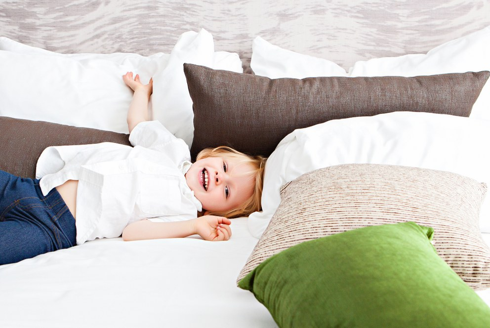 Good mattress for kids - child sleeping on parents' bed
