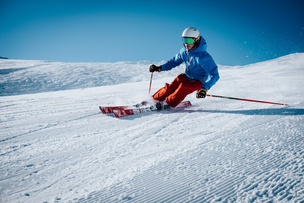 skier in action - ski holiday packing list