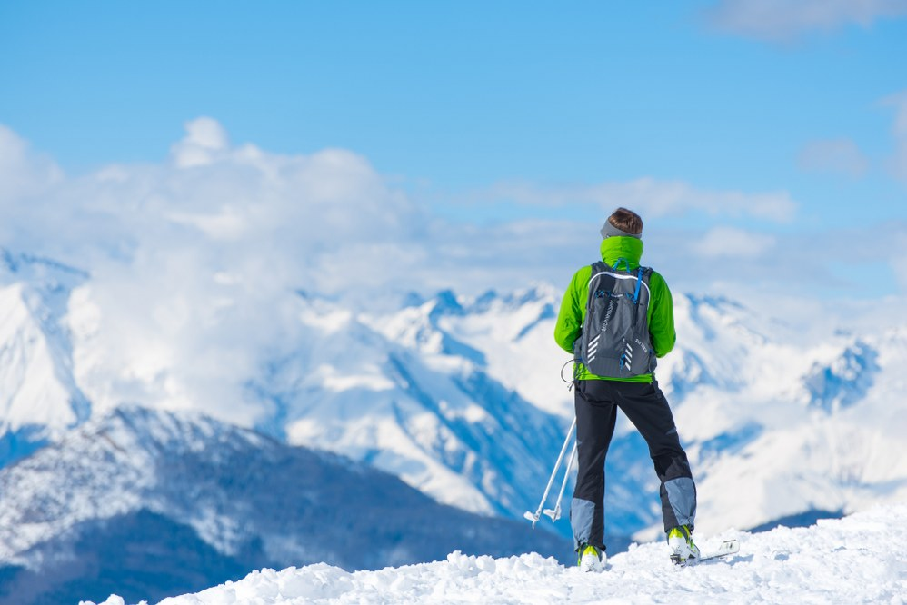 skier with rucksack for ski holiday packing list