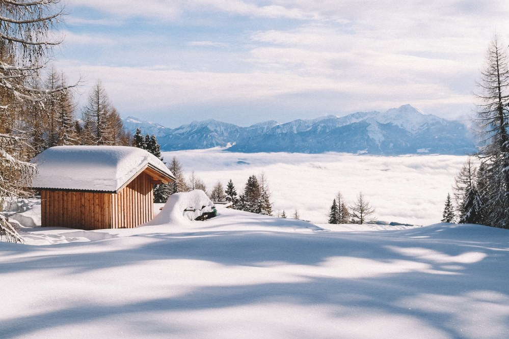 snow covered hut in winter landscape in Austria