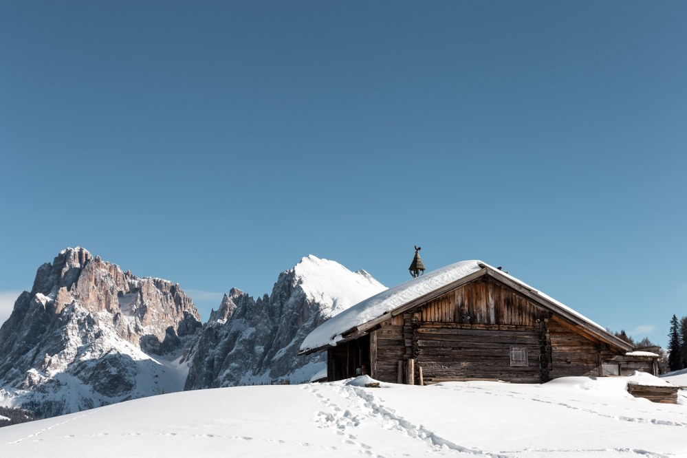 View of the two jagged peaks of the Sciliar Mountain from Seiser Alm, one of the best ski resorts 2020