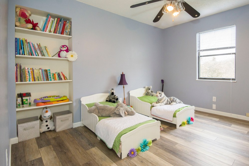cool kids bedroom with two kids beds and shelf