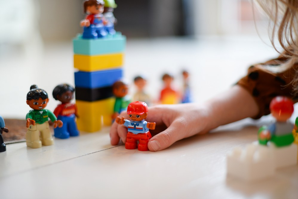 child playing with Duplo blocks and figures - cool kids bedroom