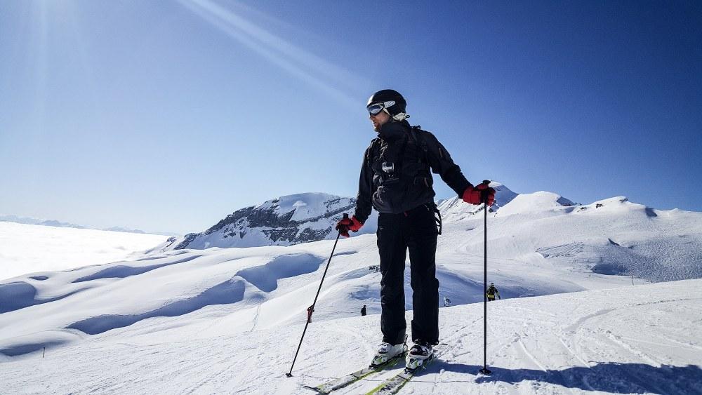 skier looking down on piste in sunshine Wilder Kaiser-Brixental - best ski resort 2020