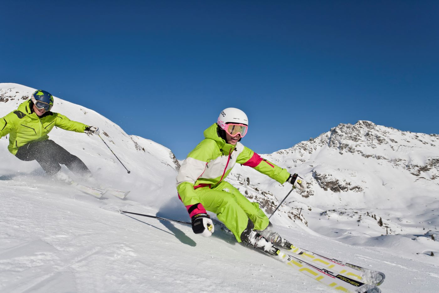 two downhill skiers on solo ski holiday