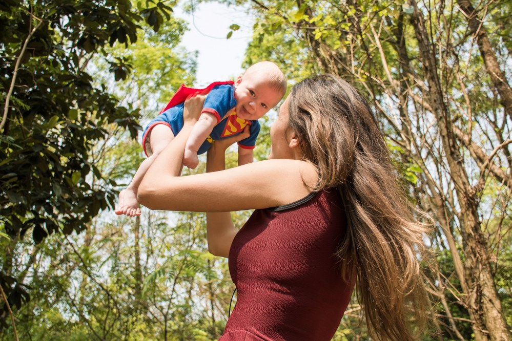 mum with baby in superman outfit - single parent quotes