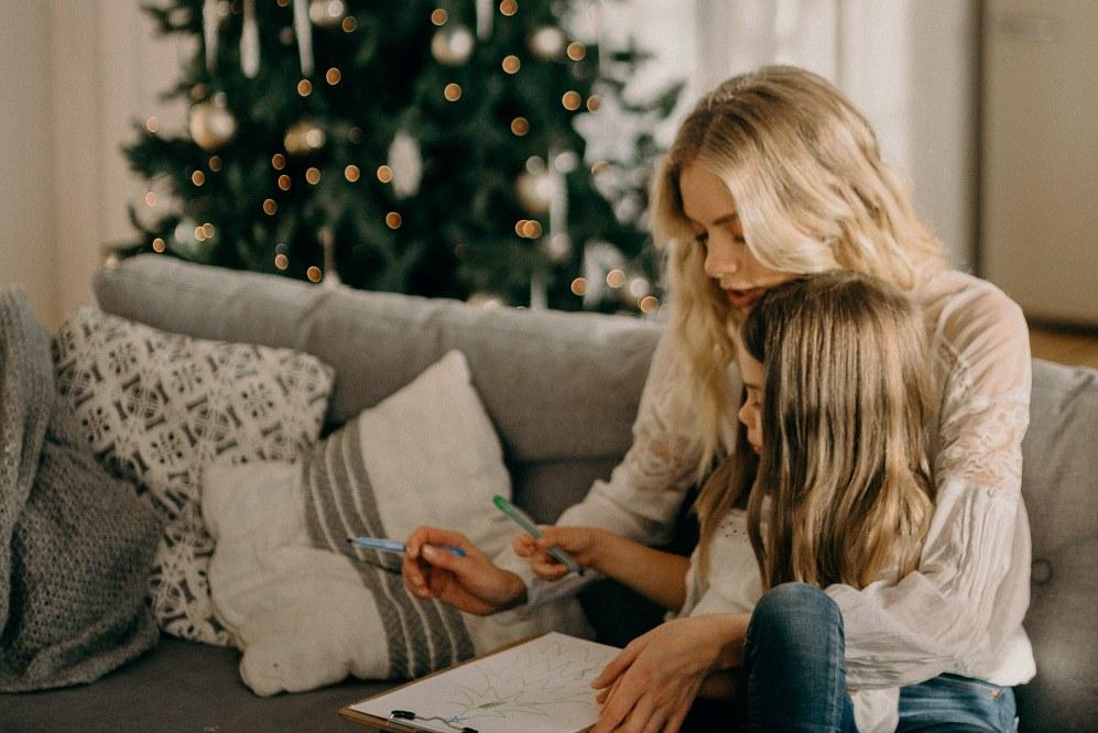 single mum and daughter drawing xmas tree