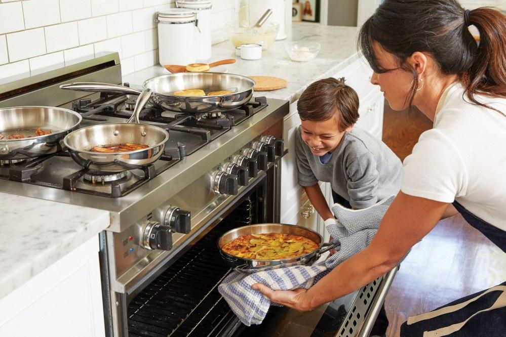 single parent mum and son baking at xmas
