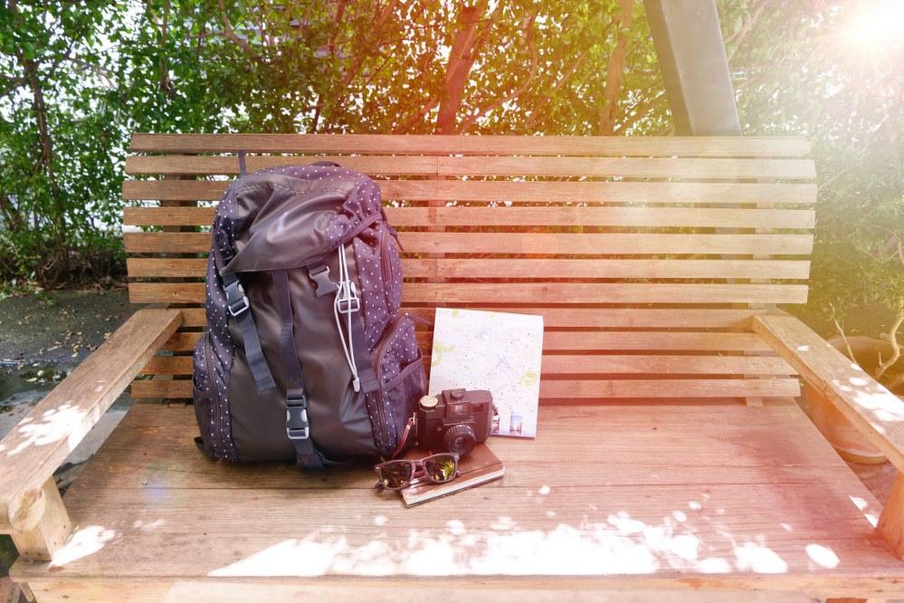 hand luggage travel rucksack on bench