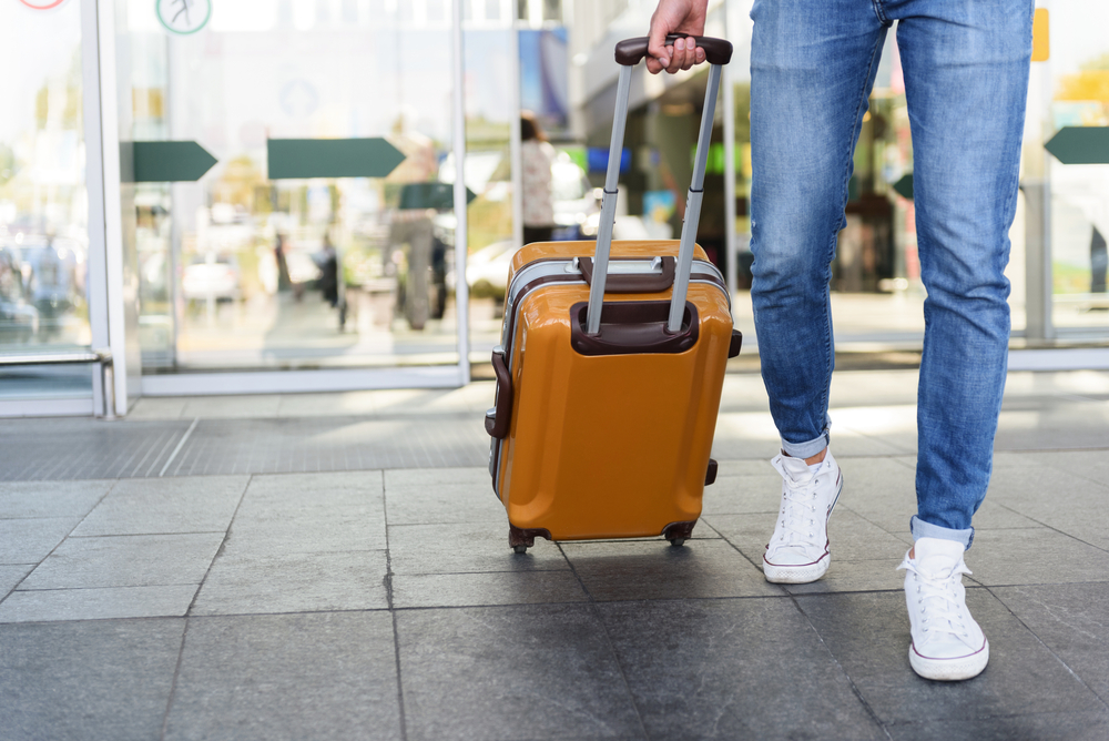 woman travelling with hand luggage case