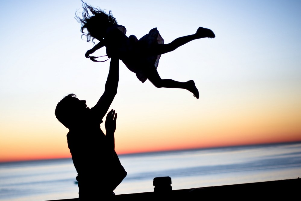single dad and daughter with sunset
