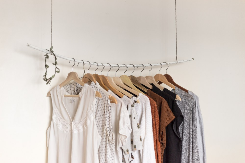 clothes on rack for hand luggage travel
