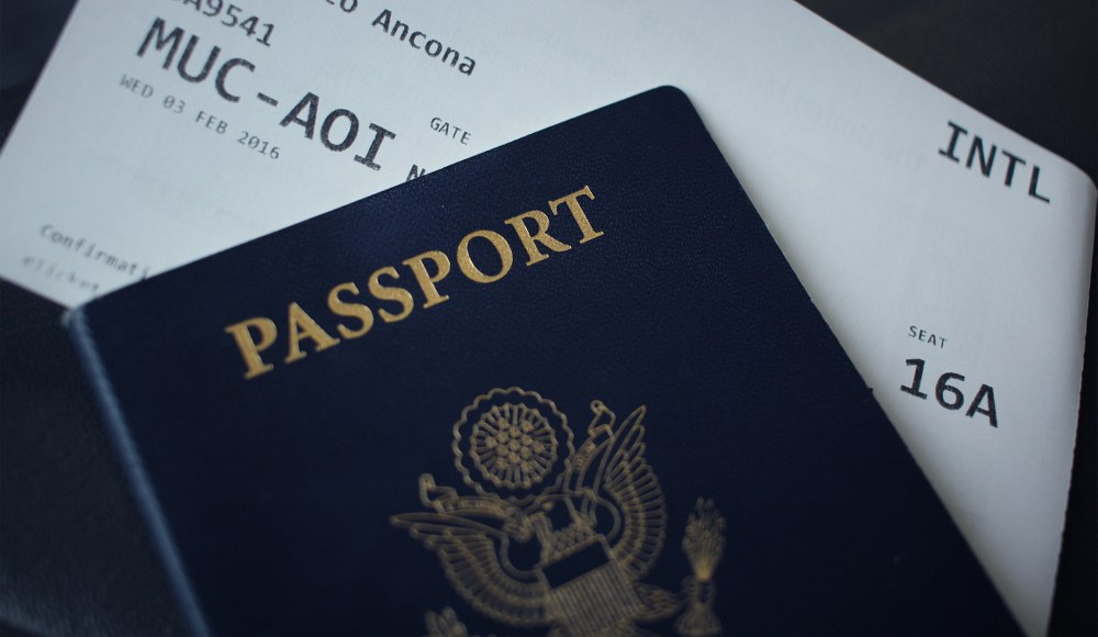 passport and boarding pass - paperwork for single mum holiday