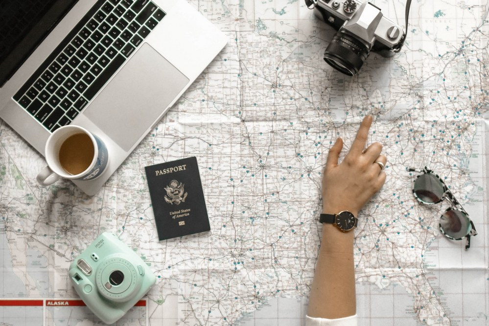 best apps for solo travellers - woman pointing at map