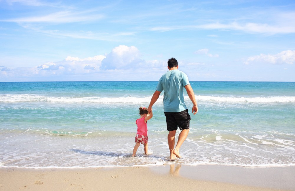 single parent with child on beach on Mykonos