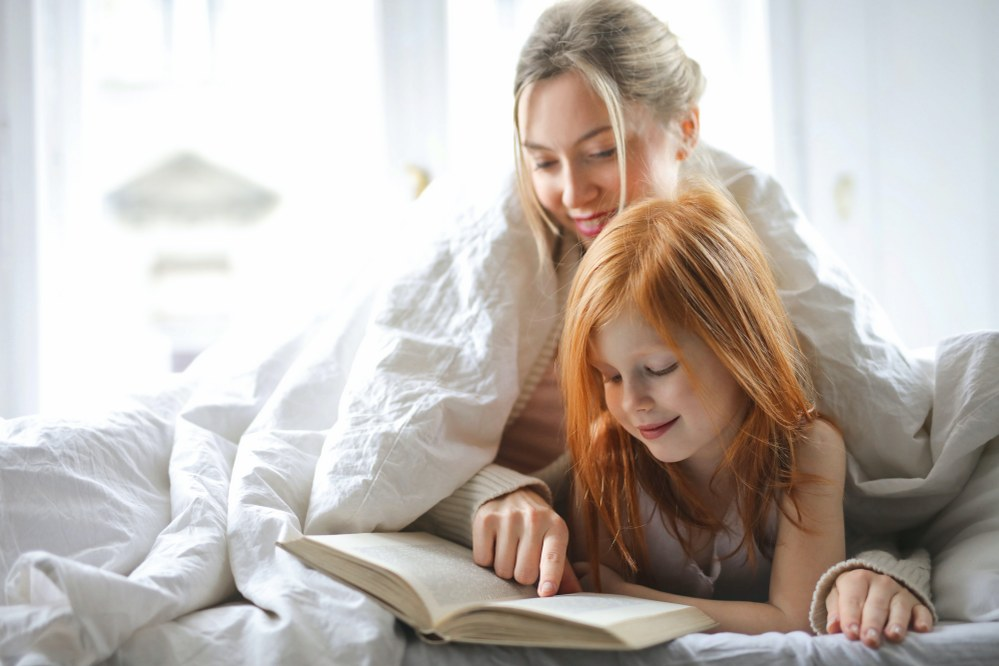 single mum and daughter in bed