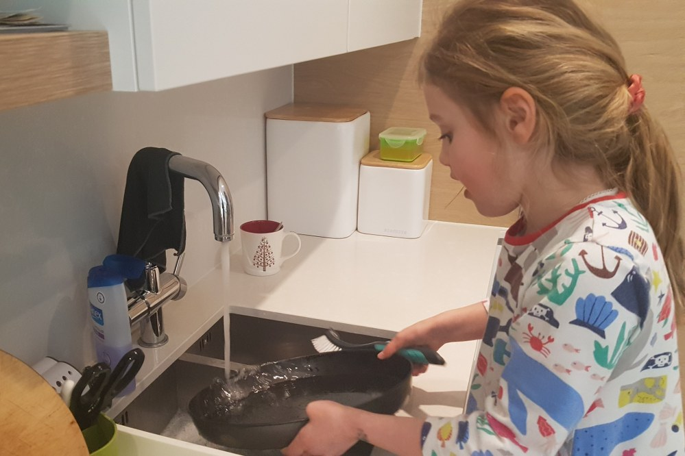 girl helping with washing up