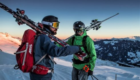 skiers in sunset