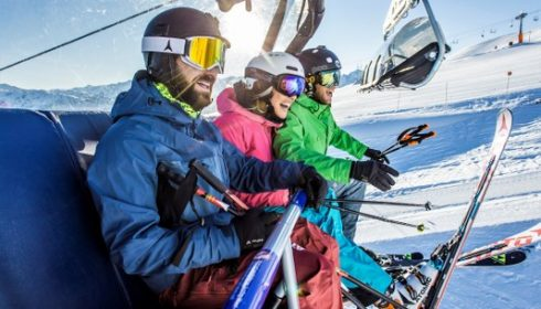 group of solo skiers on the chairlift