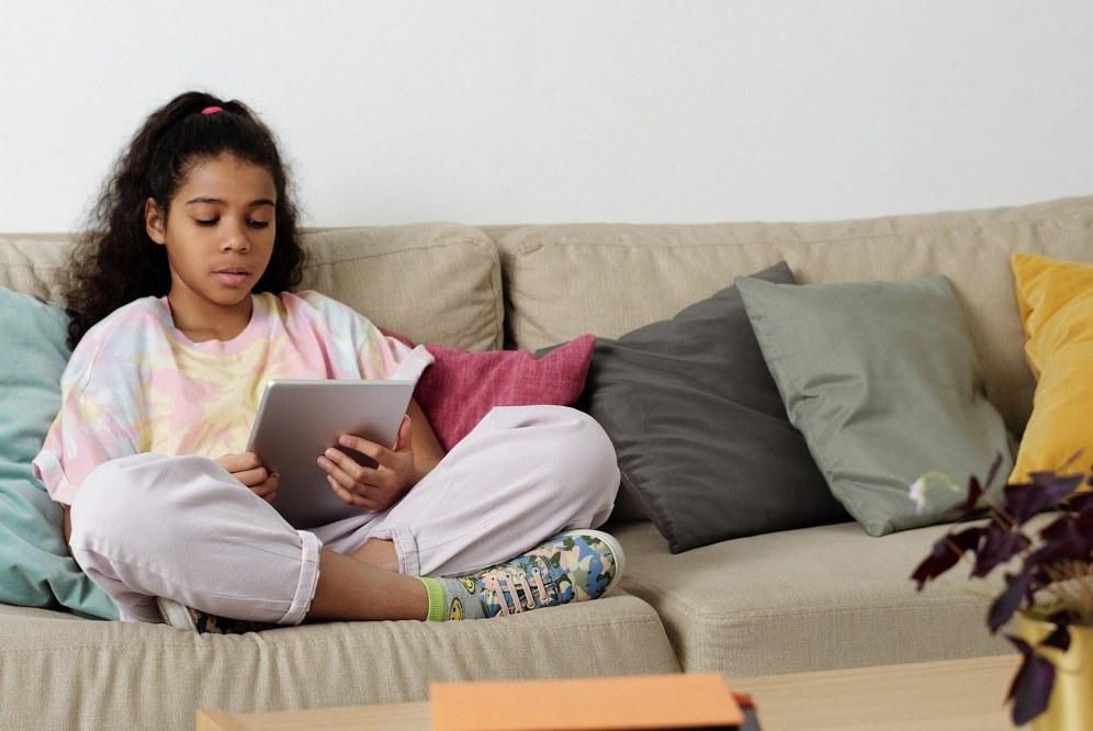 childrens books for single parents - girl on sofa reading