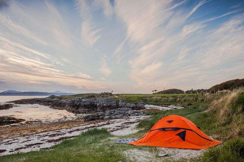 father-son holidays: orange tent near beach