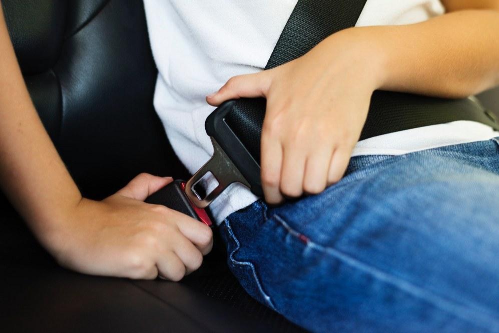 father-son holidays: boy fastening seatbelt